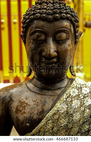 The beauty of the face and chest statue Buddha On a sunny day