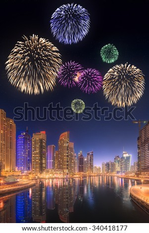 The beauty panorama of skyscrapers in Dubai Marina with fireworks. UAE