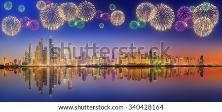 The beauty panorama of skyscrapers in Dubai Marina with fireworks. UAE - stock photo