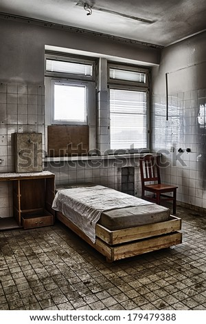 The bed in an abandoned hospital - stock photo