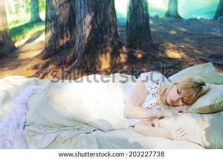 The bed in the forest, girl sleeping outdoors, concept - stock photo