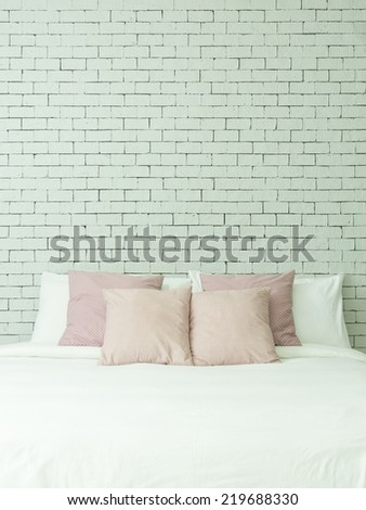 The bed on white bricks wall background vertical - stock photo