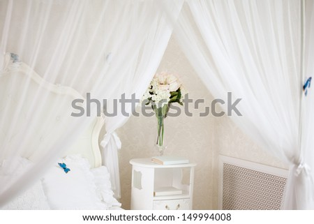 The bedroom in light pastel colors  - stock photo