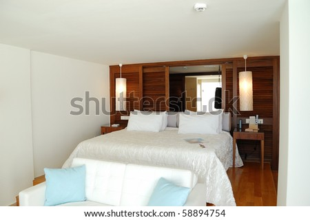 The bedroom in luxury apartment of modern hotel, Crete, Greece