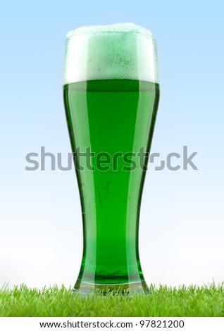The beer mug costs in a grass - stock photo