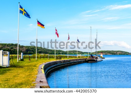 The beginning or end of the Swedish Gota canal at Mem with sailing boats moored at the pier and the archipelago in background. Fine summer weather. - stock photo