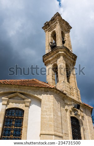 the bell tower of the Church of the Holy Cross at the village of Omodos, in the Troodos mountains of central Cyprus, an island in the Mediterranean. - stock photo