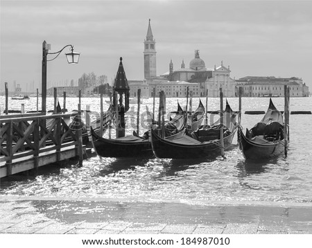 The bell tower of the Saint Giorgio Maggiore Church (view from San Marco embankment) - Venice, Italy (black and white) - stock photo