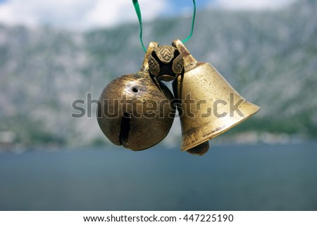 The bells on the background of the mountains - stock photo