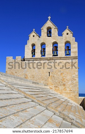 The belltower from the Church of Saintes Maries de la Mer, Camargue, France. - stock photo