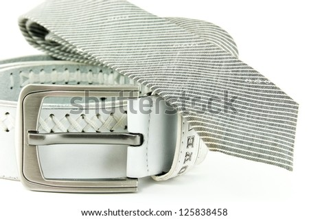 The belt and tie on a white background