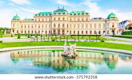 The Belvedere with a beautiful fountain in the foreground, an historic building complex in Vienna consisting of two Baroque palaces, Austria - stock photo