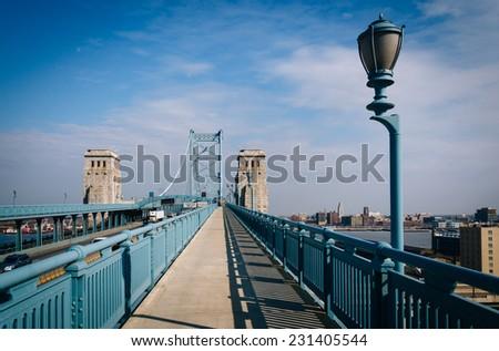 The Ben Franklin Bridge Walkway, in Philadelphia, Pennsylvania. - stock photo