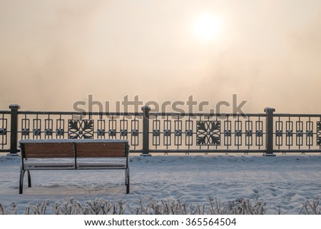 The bench on the embankment of the Yenisei river - stock photo