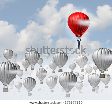 The best leadership concept with a group of grey hot air balloons in the sky and a red aircraft guided by a business leader rising above the competition as a success metaphor for leadership. - stock photo