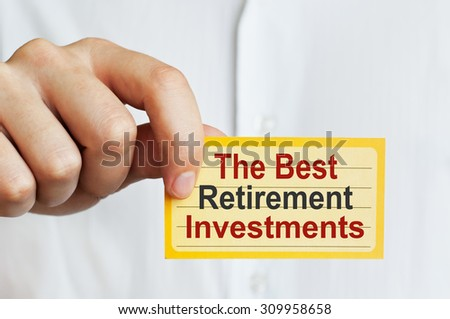 The Best Retirement Investments card in male hand - stock photo