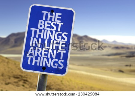 The Best Things In The Life Aren't Things sign with a desert background - stock photo