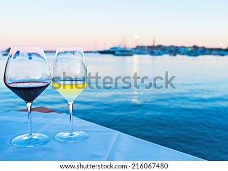 The best way to get enjoy from the sunset on Montenegro resort is to drink some wine with the view on the old town and port, Budva. - stock photo
