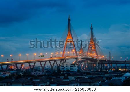 The Bhumibol Bridge across the river at twilight, The Industrail Ring Road (Bangkok, Thailand) - stock photo