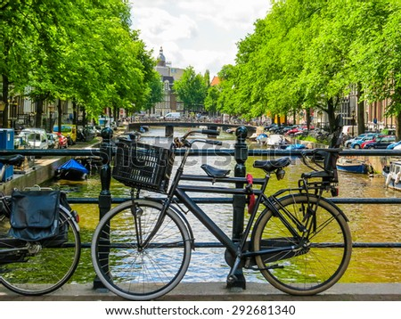 The bicycle parked on the bank of the channel, Amsterdam, Netherlands