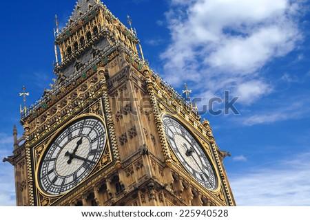 The Big Ben close up on a blue sky, England United Kingdom - stock photo