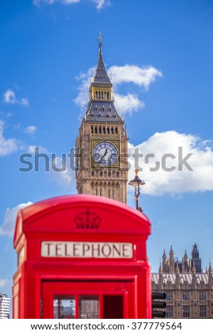 The Big Ben with traditional Red English telephone box in the foreground on a sunny afternoon with blue sky and clouds - London, UK - stock photo