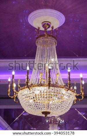 The big crystal chandelier in an ancient palace - stock photo