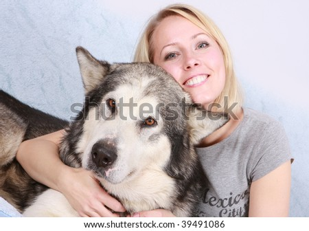 The big dog and the woman - stock photo