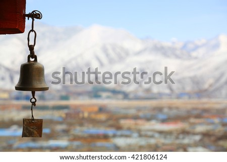 the big golden bell with dragon decorations on the roof of Jokhang Temple in Tibet, China - stock photo