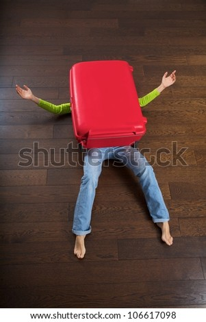 the big red suitcase killed a traveler woman - stock photo