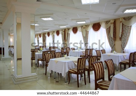 The big spacious cafe with set of tables