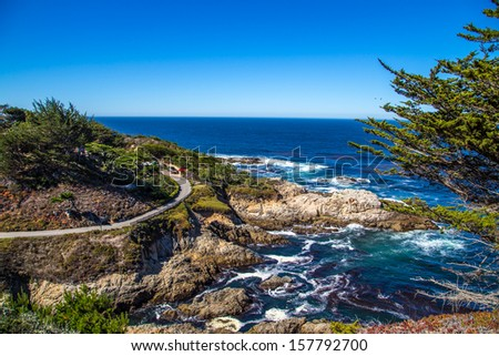 The Big Sur and its rocky coastline on a wonderful day in USA, California - stock photo