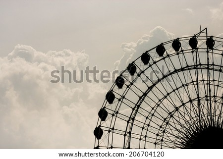 The big wheel in an amusement part in Ho Chi Minh City, Vietnam - stock photo