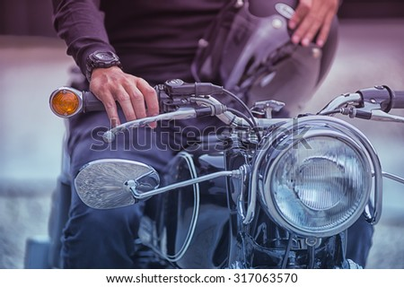 the Biker man sitting on his motorcycle, vintage effect - stock photo