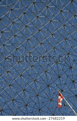 The Biosphere in Montreal detail abstact photo, small canadian flag - stock photo