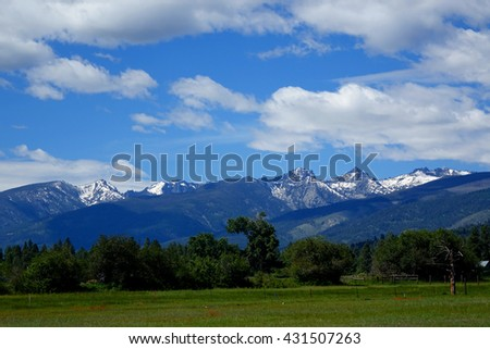 The Bitterroot Mountain range provides a beautiful background for farms and ranches in Montana.