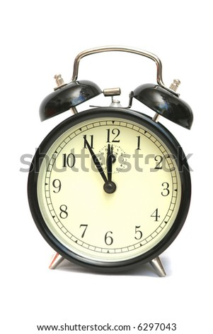 The black alarm clock is isolated on a white background