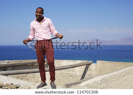 The black american handsome  man in Europe near sea