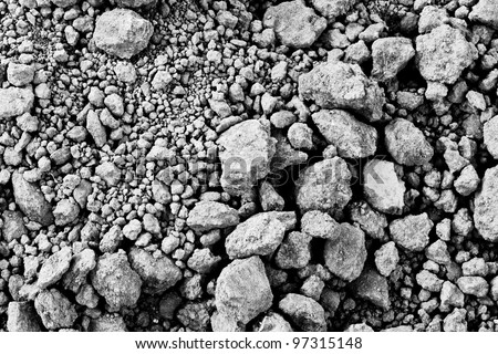 The black and white background image of the pile of dry soil - stock photo