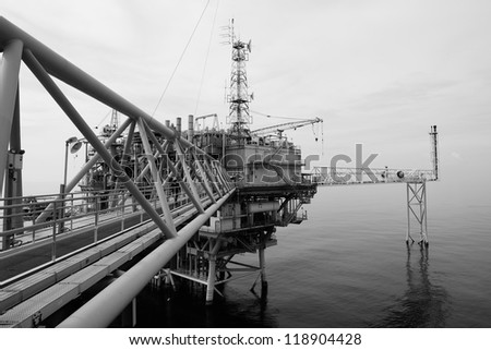 The black and white offshore oil rig in the gulf of Thailand.
