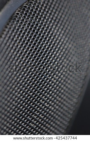 The black color filter grid guard of loudspeaker represent the speaker and sound device concept related idea - stock photo