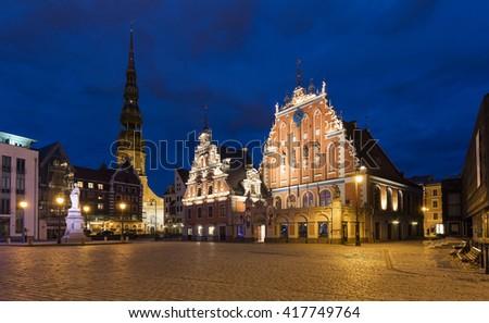 The Black Head Houses at night in Riga - stock photo