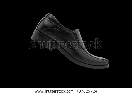 The black man's shoes isolated on black background.