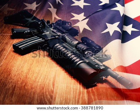 The Black Rifle with grenade launcher and U.S. flag - stock photo