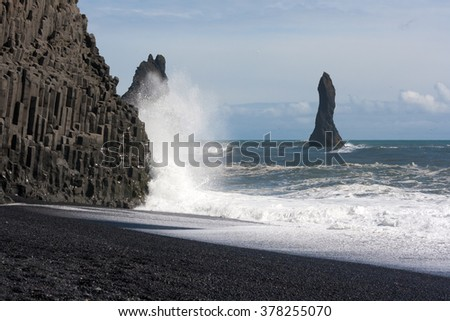 The black sand beach on the southern coast of Iceland. - stock photo