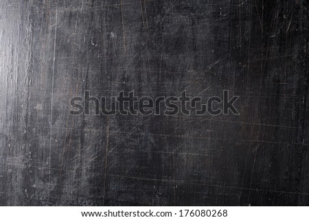 The black scratched background. board. - stock photo
