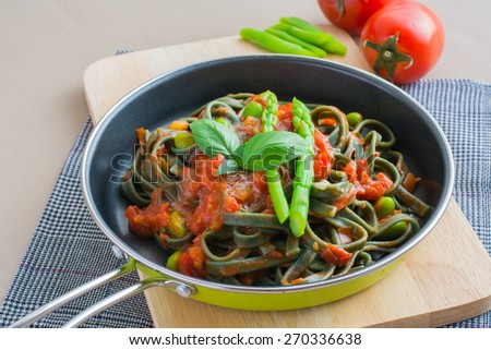 The black spaghetti with tomato sauce.