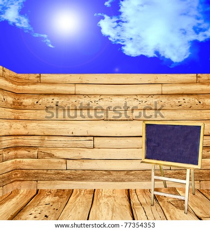 The Blackboard  on wood wall and blue sky background - stock photo