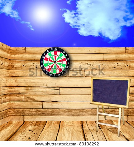 The Blackboard  on wood wall and blue sky background