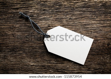 the blank price tag label on wooden background - stock photo
